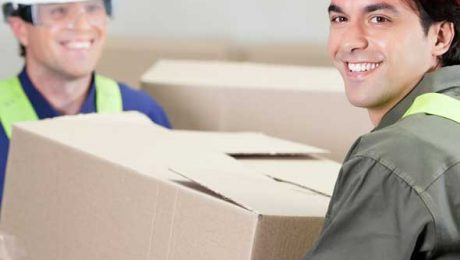 Two People Moving a Box